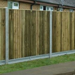 Featheredge panels with lightcast slotted concrete posts and gravel boards