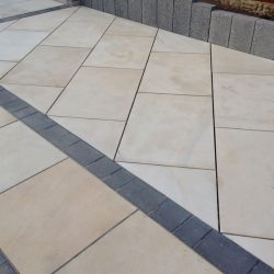 800mm x 400mm Ivory Pure sawn and honed sandstone with graphite driveflair mixed block pavers as a border