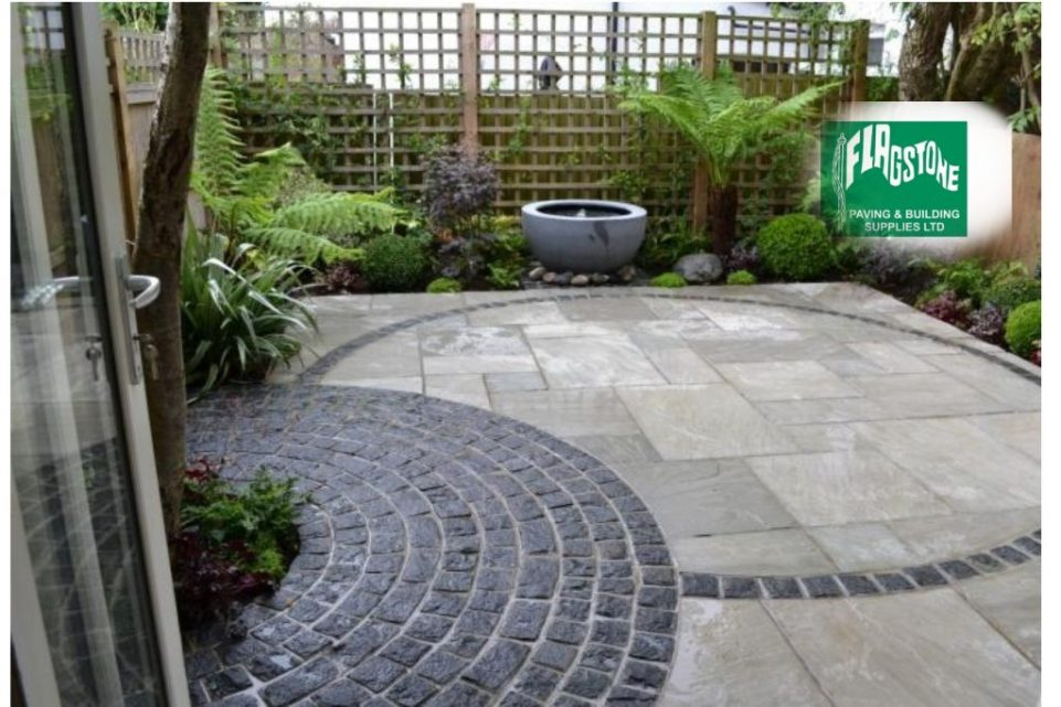 Mountain mist natural sandstone and black granite setts pointed with Geofix allweather jointing compound in slate grey colour