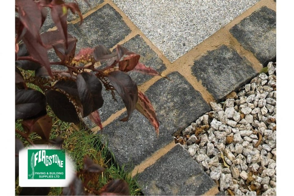 black granite setts bordering silver grey granite
