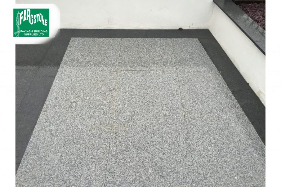 Silver grey and mid grey granite shown wet